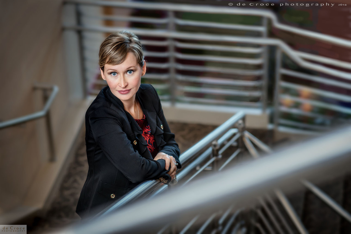 Executive woman portrait photo on stairs
