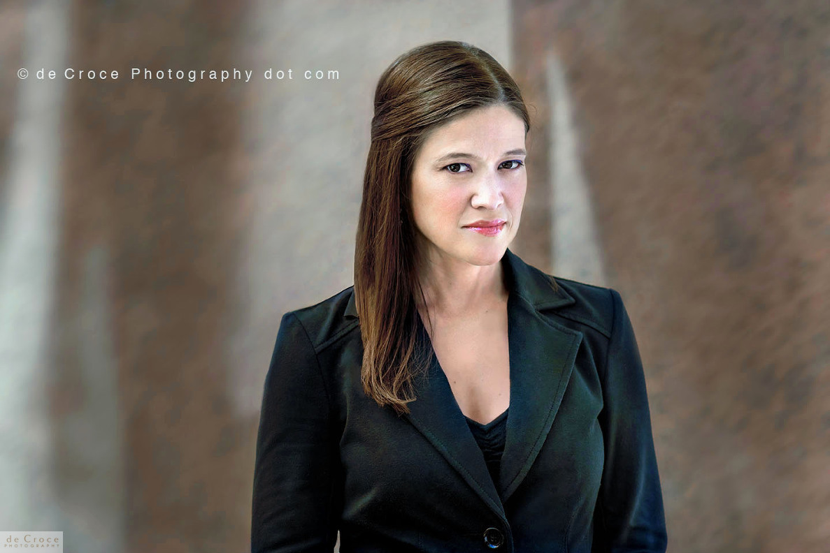 Denver lawyer in woman executive portrait photography with light and shadow background