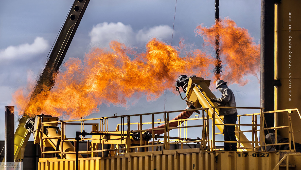 Colorado oil and gas flare stack at drilling site.