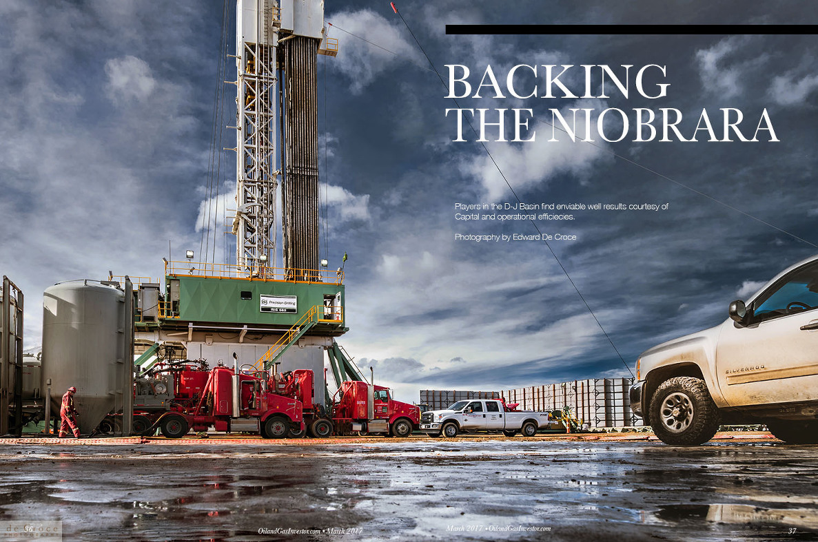 Colorado industry photography - ice and truck at drilling rig.